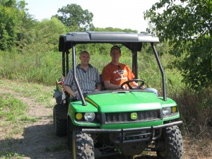 Volunteers driving 4WD John Deere Gator